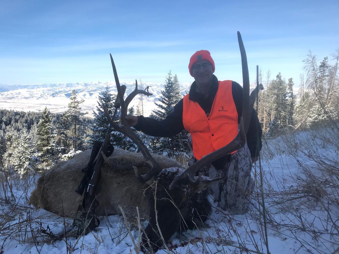 elk with rifle.jpg